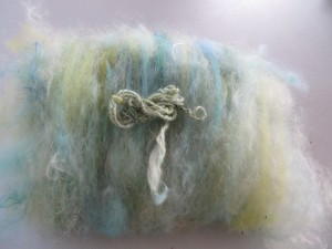 Mixed Batt in subtle shades of blue, yellow and green