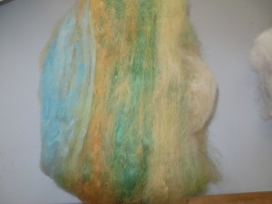 A batt primarily made from alpaca, but also included is wool and mohair, all dyed in the colours of the Australian Summer.  It's ready for spinning or felting.